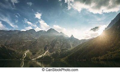 Tatra National Park, Poland. Famous Mountains Lake Morskie Oko Or Sea Eye Lake In Summer Evening. Beautiful Sunset Sunrays Above Tatras Lake Landscape. UNESCO's World Network of Reserves