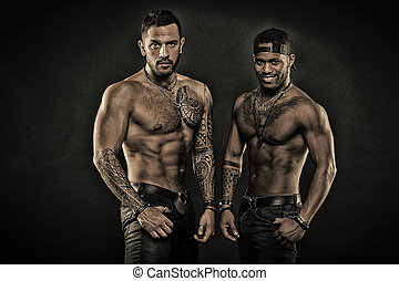 Tattoo addicts. Sexy men with muscular torso. Brutal macho style. Muscular men with fashionable tattoo style. Looking sexy, vintage flter