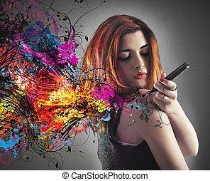 Tattoo draw - Girl draws a tattoo on his arm