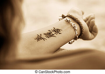 Tattoo Hand - A woman\'s hands with a beautiful henna...