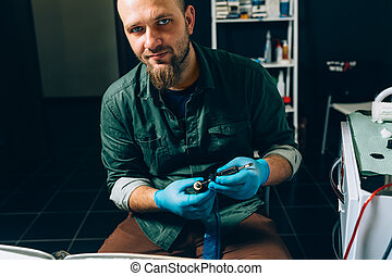 tattoo master artist prepares tools for tattooing