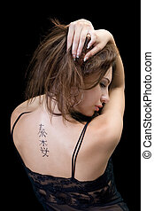 Tattoo on a back of the young woman