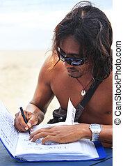 tattoo - Asian the man at the coast, making tattoos henna