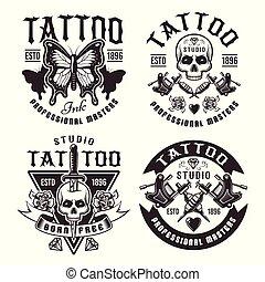 Tattoo studio set of four vector vintage emblems
