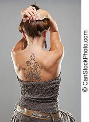 Tattoo woman portrait in studio shoot