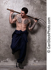 Tattooed guy with pitchfork