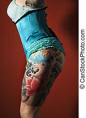 Tattooed womans leg - Side of womans tattooed leg