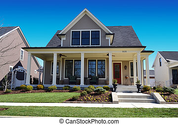 Taupe cape cod house