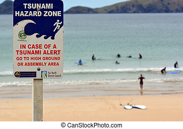 TAUPO BAY, NZ - FEB 14:Tsunami hazard zone sign on Feb 14 2014.NZ was hit by 15m high tsunami in the 15th Century and in last 150 years four tsunami events have impacted Northland east coast.