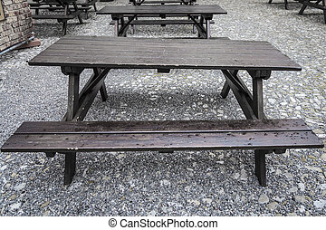 Tavern style forniture - Focus on wet old and awry wood ...