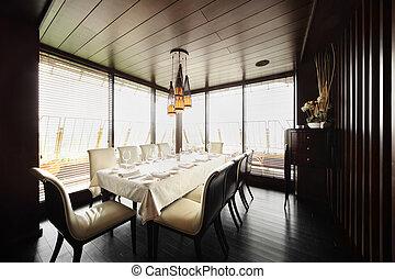 tavola, con, bianco, tovaglia, e, servire, e, bianco, sedie, in, vuoto, ristorante