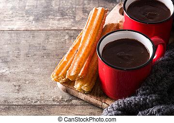 tavola legno, cioccolato caldo, churros