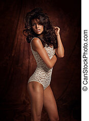 Tawny woman wearing bright lingerie