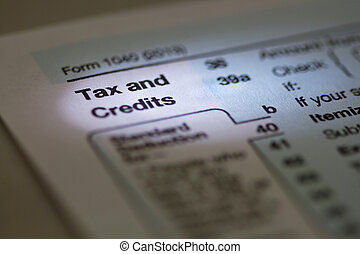 Tax and Credits 1040 IRS Tax Form - Macro horizontal photo...