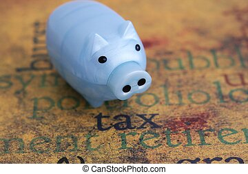 Tax and piggy bank concept