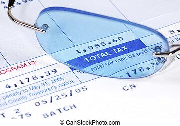 Tax Bill - Eyeglasses on a tax Bill.