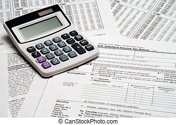 Tax Calculator - A calculator sitting on top of tax forms.