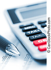 Tax calculator and pen - Calculating numbers for income tax ...
