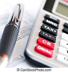 Tax calculator and pen - Calculating numbers for income tax...