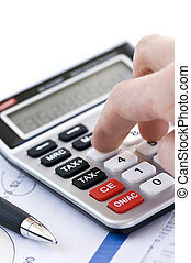 Tax calculator and pen - Typing numbers for income tax ...