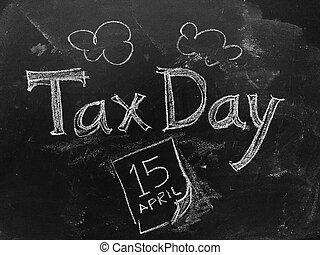 Tax Day April 15 handwritten on Blackboard as JPG File