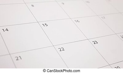 Hand write word tax into calendar