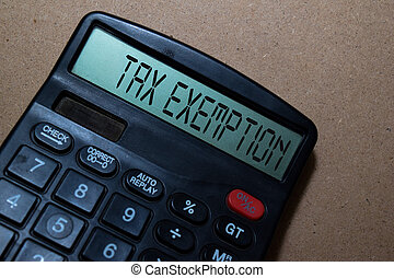 Tax Exemption write on calculator isolated on white board background.