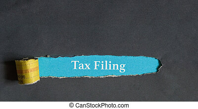 Tax filing concept : words on a torn hole - File tax return...