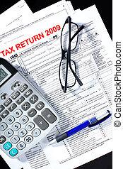 Tax form, calculator, pen