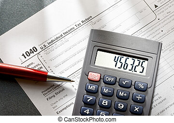 Tax form, red pen and calculator