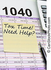 Tax forms 1040, spread sheet with pen, calculator and sticker.
