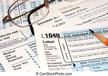 Tax forms with glasses and pencil