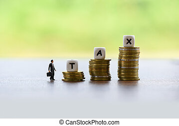tax increase concept and finances businessman and stacked coins