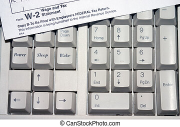 Tax Keyboard - USA Tax Return Form on computer keyboard for...