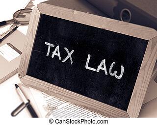 Tax Law Concept Hand Drawn on Chalkboard.