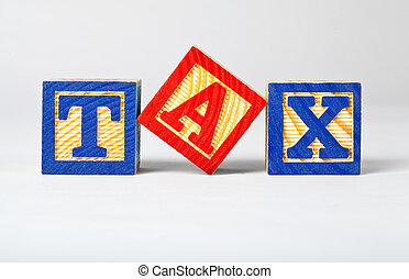 Tax - Letter bricks spelling out 'TAX'.