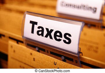 taxes - tax or taxes concept with word on business folder...