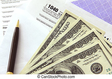Tax papers with 100 dollar bills - Tax papers in an envelope...