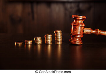TAX payment concept. Stack of coins with judge gavel