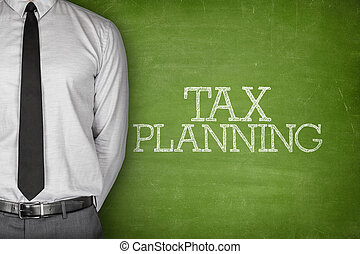 Tax planning text on blackboard