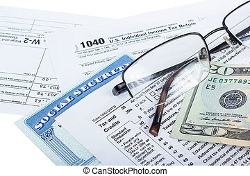 Tax preparation - American federal tax form 1040 with money...