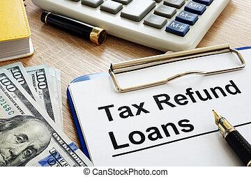 Tax Refund Loans application form on a desk.