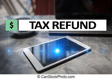 Tax refund text on virtual screen. Business and Finance concept.