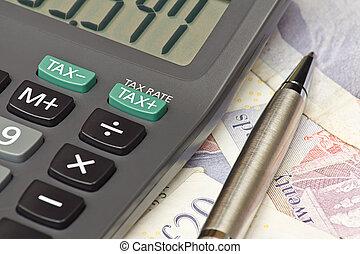 Tax return calculator - Calculator and pen symbolizing...