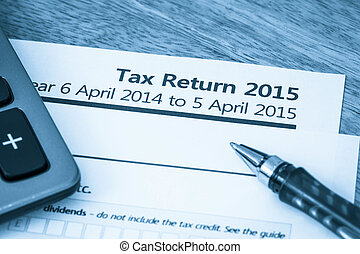 Tax return form 2015 - Cool toned image of UK income tax...