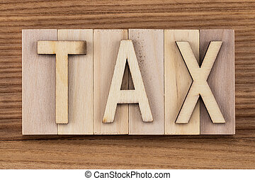tax - text in vintage letters on wooden blocks