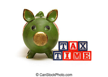 Tax Time - A pig bank and blocks remind people of the tax...