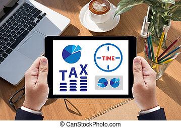 TAX TIME   Business team hands at work with financial reports