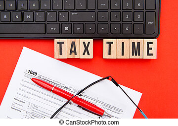 Tax Time - USA - wooden letters with 1040 Tax Form,...