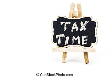 TAX TIME written on chalkboard on white background